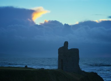 Stormy skies beyond the castle ruin at Ballybunion, Co. Kerry (file).