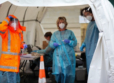 Medical workers work at a temporary Covid-19 testing site in Auckland, New Zealand