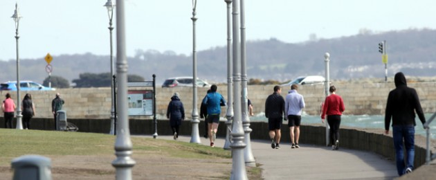 People walking on the seafront at Clontarf in Dublin last month.