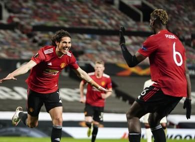 Manchester United's Edinson Cavani, left, celebrates.