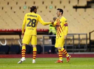 Messi celebrates with Oscar Mingueza.