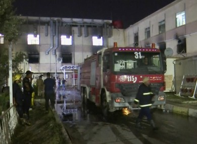 First responders work the scene of a hospital fire in Baghdad.