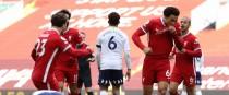 Liverpool's Trent Alexander-Arnold celebrates scoring the winner.