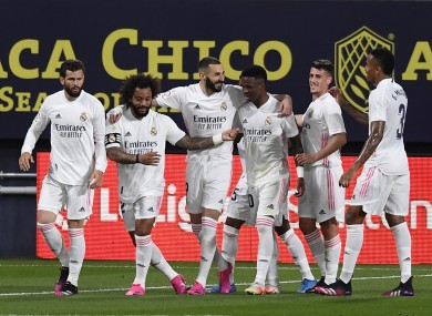Karim Benzema celebrates with the Real Madrid players.