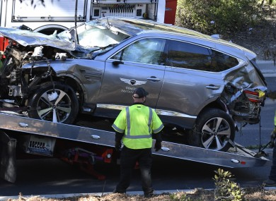 Tiger Woods' car is removed from a hill after he was involved in a crash.