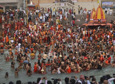 Devotees take holy dips in the Ganges River during Kumbh Mela, or pitcher festival, one of the most sacred pilgrimages in Hinduism, in Haridwar, northern state of Uttarakhand, India.