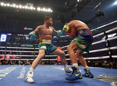 Canelo, left, added Saunders' WBO title to his collection.