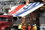 File photo shows workers unloading debris, belonging to crashed Air France flight AF447, in the port of Recife, northeast of Brazil.