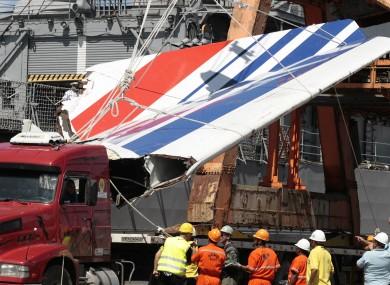 File photo shows workers unloading debris, belonging to crashed Air France flight AF447, in the port of Recife, northeast of Brazil.