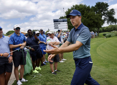 Jordan Spieth reacts to fans after he finished round one in the Charles Schwab Challenge at the Colonial Country Club in Fort Worth.