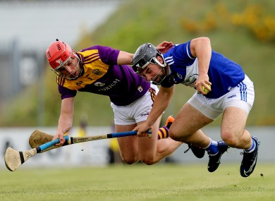 Wexford's Gavin Bailey and Lee Cleere of Laois.