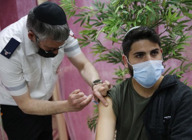 An Israeli man receives a dose of Covid-19 vaccine in a clinic in the central Israeli town of Kfar Chabad.