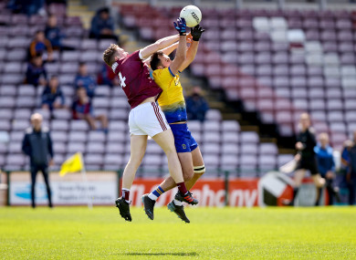 Galway's Jack Glynn with Donie Smith of Roscommon.
