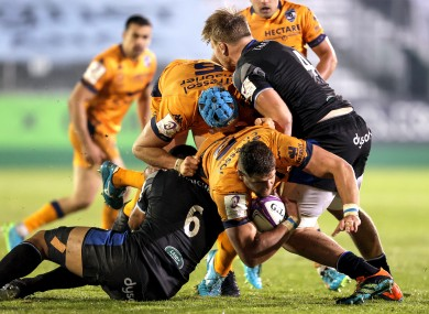 Montpellier's Paul Willemse is tackled by Taulupe Faletau of Bath.