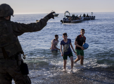 Migrants arrive at the Spanish enclave of Ceuta, near the border of Morocco and Spain, early Wednesday, May 19, 2021.
