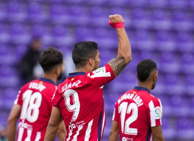 Luis Suarez celebrates the goal that won the title.