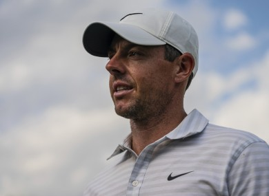 Rory McIlroy walks off after finishing on the 18th hole.