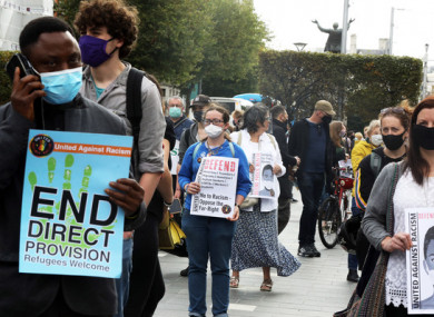 Protesters wearing face masks during an anti-racism demonstration in Dublin last year.