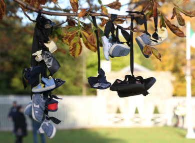 Baby shoes tied to a tree during a Mother and Baby Home protest event at Aras an Uachtarain