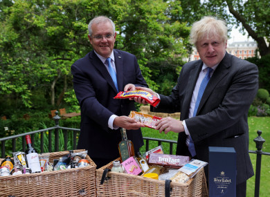 Boris Johnson and Australian Prime Minister Scott Morrison exchange biscuits at a photo opp in Downing Street