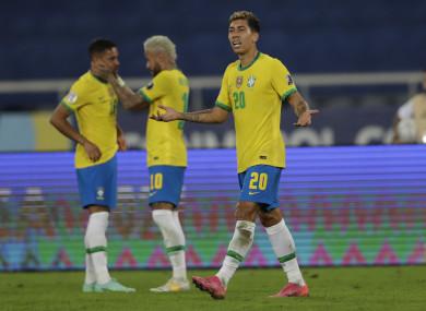 Roberto Firmino after scoring Brazil's opener.