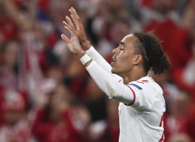 Denmark's Yussuf Poulsen celebrates after scoring.