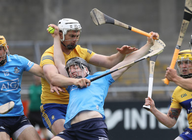 Donal Burke is tackled by Conor Cleary.