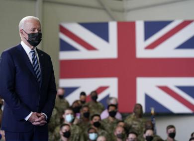 President Joe Biden listens as first lady Jill Biden speaks to American service members at RAF Mildenhall in Suffolk, England.