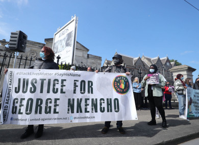 Protesters outside the RDS in Dublin as the inquest opens for George Nkencho.