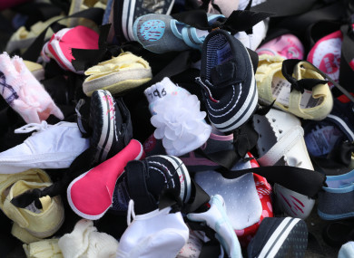 Baby shoes with black mourning ribbon were laid on the railings of the Commission's office in February in protest.