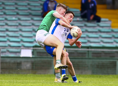 Limerick's Robert Childs tackles Waterford's Stephen Curry.