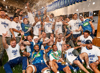 The Blues players celebrate after the game in the dressing room.