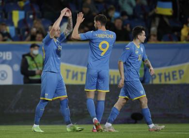 Ukraine's Oleksandr Zubkov, left, celebrates with Roman Yaremchuk after scoring.