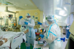 Medics wearing special suits to protect against coronavirus prepare to treat a patient at the City hospital No. 52 in Moscow, Russia on Thursday.