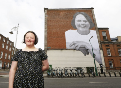 Campaign ambassador Amanda Butler with the 'Don't Talk Down to Me' mural in Dublin today.