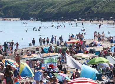 Bathers in Brittas Bay in Wicklow yesterday