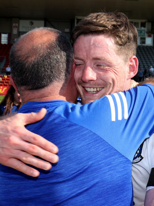 Monaghan's Conor McManus celebrates their win with manager Seamus McEnaney.