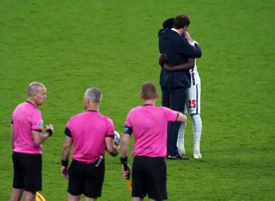 England manager Gareth Southgate consoles Bukayo Saka after the penalty shoot out.