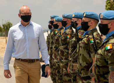 Minister for Defence and Foreign Affairs inspecting an Irish guard of honour in Lebanon today.