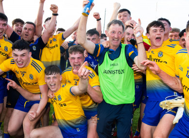 Roscommon manager Liam Tully celebrates winning with his team.