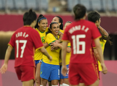 Marta celebrates scoring today.