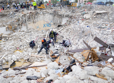 Rescue teams working at the residential building collapse site last week.