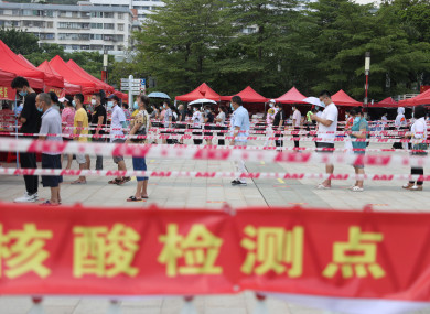 Residents line up for Covid-19 test at a testing site in Xiamen, southeast China's Fujian Province,