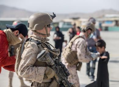 A US marine provides security during evacuation flights at Hamid Karzai International Airport at the weekend.