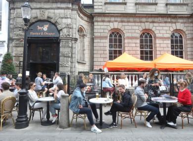 People enjoying outdoor dining in Dublin city