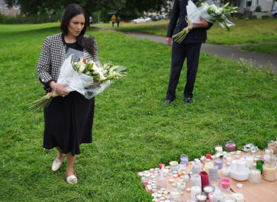 Home Secretary Priti Patel lays a bouquet of flowers in Plymouth, Devon.