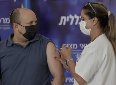 Israel's Prime Minister Naftali Bennett receives a booster shot.