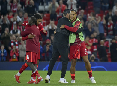 Virgil van Dijk (right) and Jurgen Klopp hug at the final whistle of Wednesday's Champions League win.
