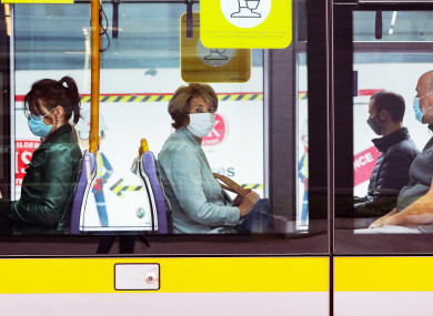 File photo of people wearing face masks on the Luas in Dublin