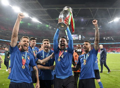 Italy celebrate with their trophy.